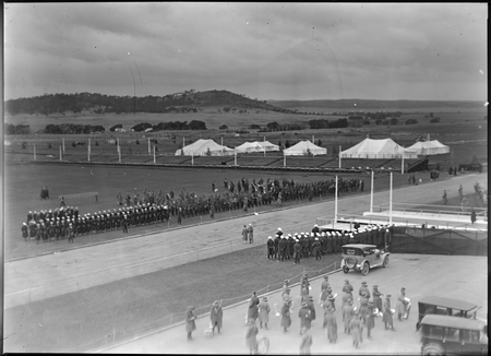 Royal Visit, May 1927. View from front of Parliament House looking east at troops, band, spectator stands and tents. Mount Pleasant in background.