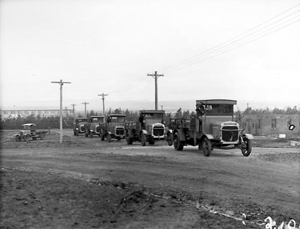 Five Thorncroft motor trucks and a smaller motor truck