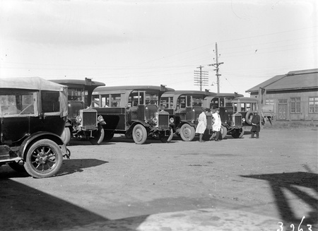Five AEC motor buses with crews at Kingston Depot.