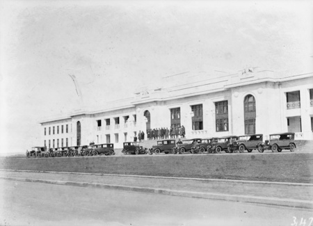 Parliament House, convoy of motor cars.