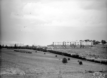 Parliament House on left and West Block  Offices from the grounds of Hotel Canberra