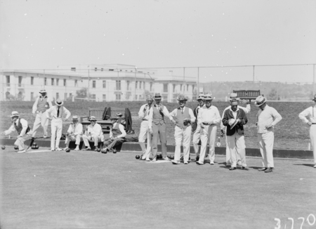 Visit by the Ashfield Bowling Club of Sydney. Game of bowls on the Parliament House greens.