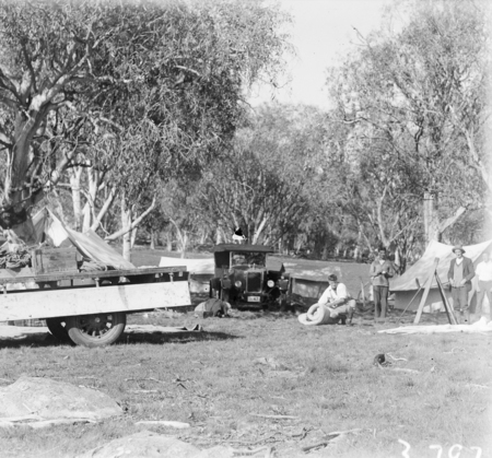 Surveyors camp with motor car and motor truck.
