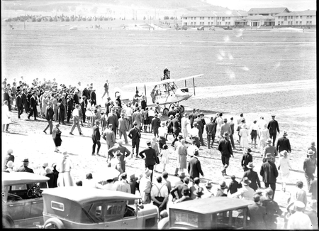 "Landing of Captain W.N. Lancaster and Mrs Keith Miller aircraft ""Red Rose"" at the Review Ground opposite Hotel Kurrajong."