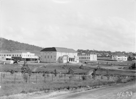 Manuka, showing Capitol Theatre, shops and Catholic Convent, Institution of Engineers commemorative tree planting in foreground.