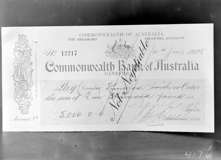 Cheque for Five thousand pounds presented  to Kingsford Smith, signed by Treasurer Dr Earle Page and the Prime Minister S.M.Bruce