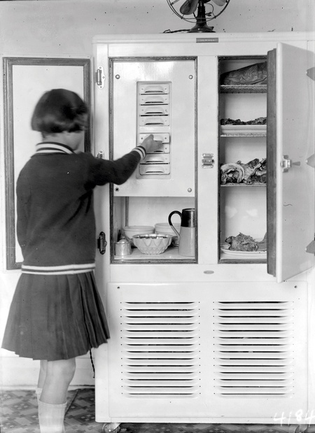 Girl at a two door  refrigerator