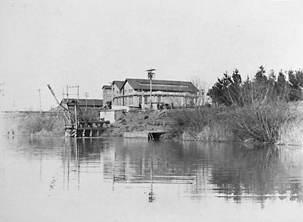 Kingston Power Station from the weir on the  Molonglo River,showing water  supply pipes .Used as a swimming  pool