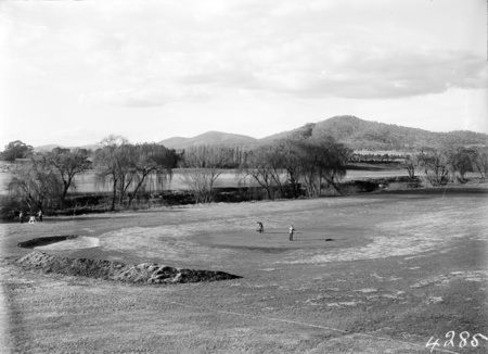 Golfers on the green, Molonglo River behind.