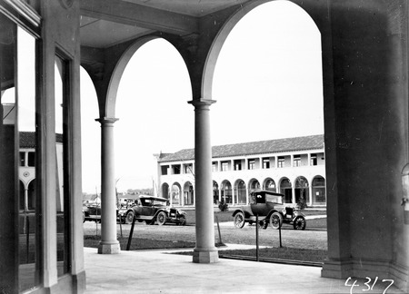 Sydney Building, Northbourne Avenue and Motor Cars from Colonnades of Melbourne Building