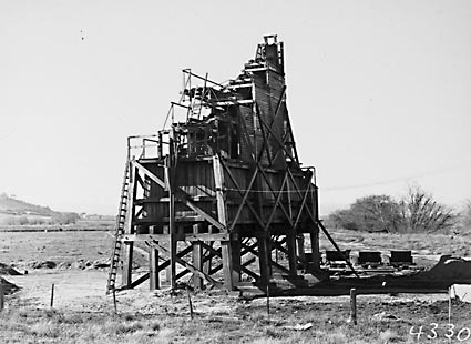 Sand washing and screening  plant with narrow gauge tram tracks and skips on the banks of  the Molonglo River