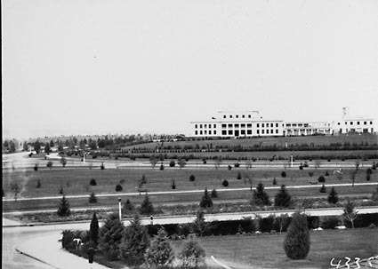 Parliament House from Hotel Canberra showing young trees