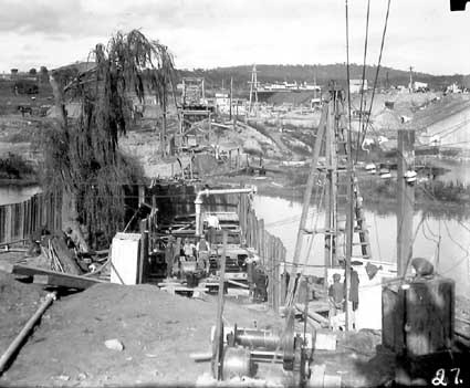 Excavation workings - Sewerage mains,under the Molonglo River. Hotel Canberra (background) and Commonwealth Bridge (right)