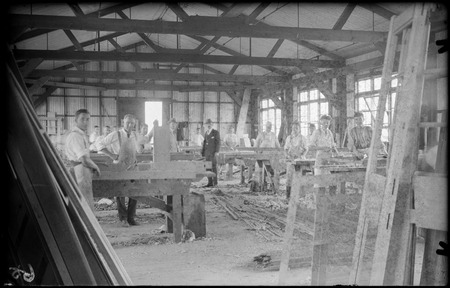 Interior of carpenters shop with workmen and foreman at Eastlake.