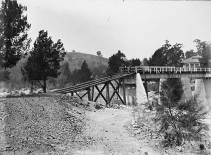 Flood damage to bridge over the Murrumbidgee River near the Cotter Pump House - 1922 floods - Reconstruction of western abutments