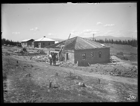 Cottages under construction at Mount Stromlo.