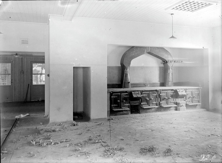 Gorman House kitchen showing store room and cooking stoves
