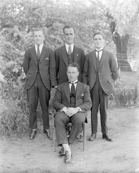 Four unidentified men (George O'Neill in the centre, standing).