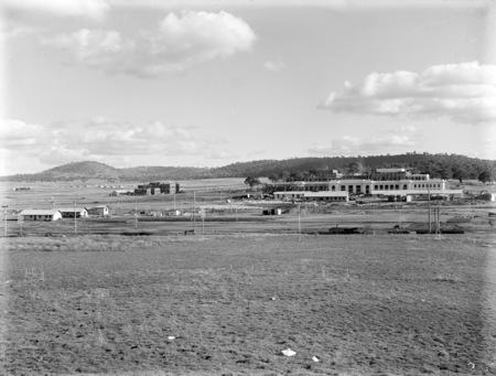 Parliament House and East Block under construction, Mt. Mugga at rear.