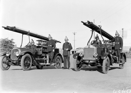 Canberra Fire Brigade with uniformed firemen and appliances, one on the right is an Albion.