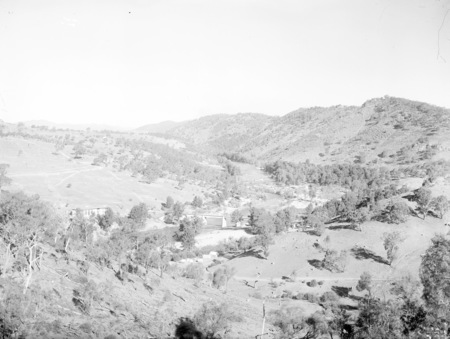 Murrumbidgee River Bridge and Cotter Pump House. Construction camp in foreground following the flood damage of 1922 and rebuilding the bridge.