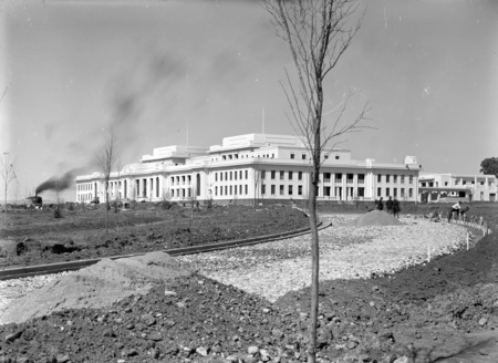 Parliament House from west side of Parkes place with steam shovel contructing King George Terrace.