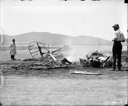 Aircraft crash showing engine. Single seat Scout Experimenter prefix A2 crashed at the opening of Parliament on 9 May 1927 on Rottenbury Hill at the site of St Marks Church, Blackall Street, Barton. Pilot Flying Officer EWEN was killed and is buried in St John's churchyard. See Canberra Times 13 May 1927 for details.
