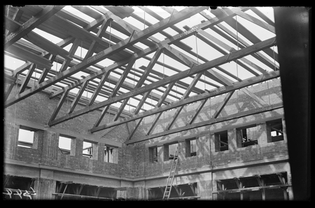 Parliament House under construction showing roof trusses.