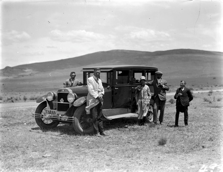 Hudson motor car with five unidentified figures, Canberra
