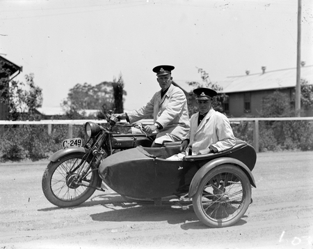 NSW Police Officers on AJS motorcycle with side car. Constable Bill Bottwell on bike, Constable Lowther in side car.