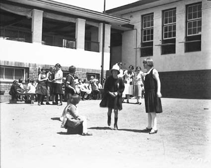 Rear of Telopea Park School with girls playing hopscotch