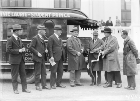 Federal Capital Commissioners with the promotors of the Metro Goldwyn Mayer trackless train outside Parliament House.