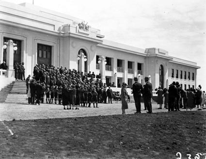 Group of Empire Parliamentary Association delegates in front of Parliament House. Canberra Boy Scouts providing the Guard of Honour