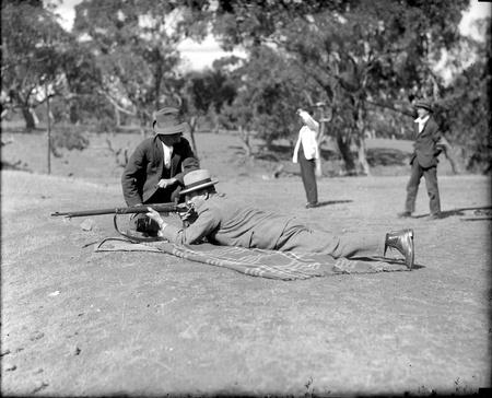 Mt Ainslie Rifle range. Sir John Butters shooting.