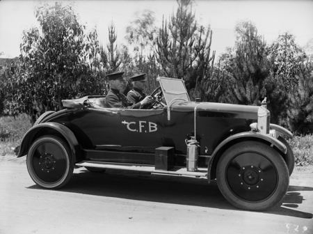 Chief Fire Officer Perc Douglass and Station Officer, Driver Bill Maloney, in official car (Armstrong Siddely).