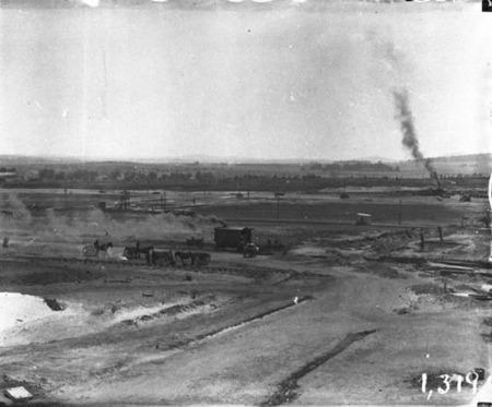 Panorama showing horse drays, steam excavator, sewerage excavation workings and brickworks railway