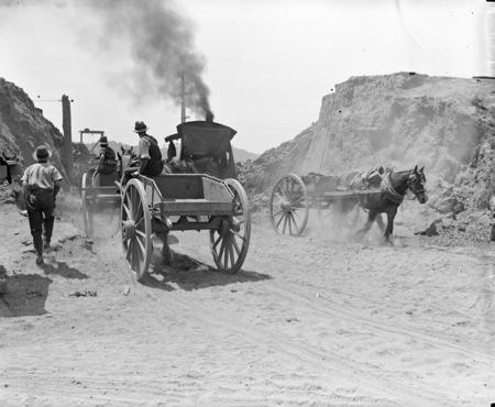 Keystone steam excavator at work on embankment of Commonwealth Avenue Bridge with horse drawn drays.