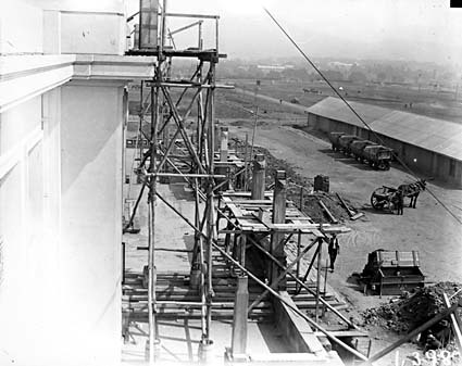 View from roof of Parliament House showing front facade, construction buildings and brickworks railway