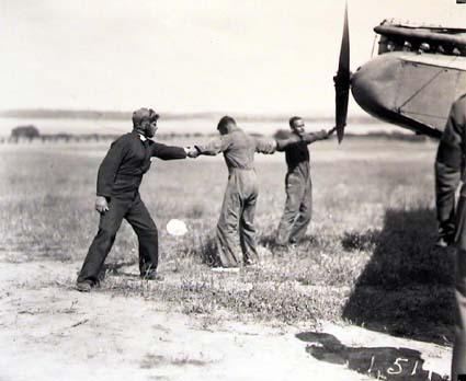 Winding propeller to start the engine of De Havilland DH9 aeroplane