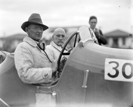 Two contestants in a 100 MPH 3 litre Bentley for the RACV Alpine Rally. Driver Fred Brodribb. A half mile speed test was held in Canberra; the Bentley recorded 74 mph.