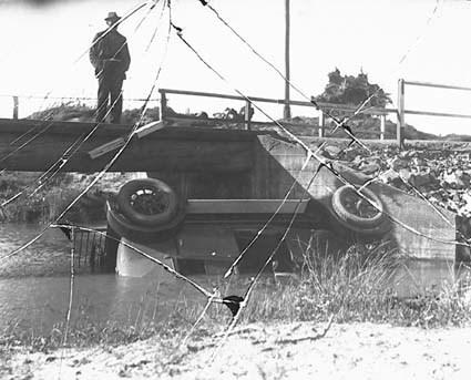 Motor car overturned in river