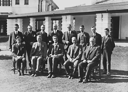 Presentation of Charter of Rotary Club, group photo [Sir Robert Garran, Sir John Butters and CS Daley can be identified] in front of Hotel Canberra