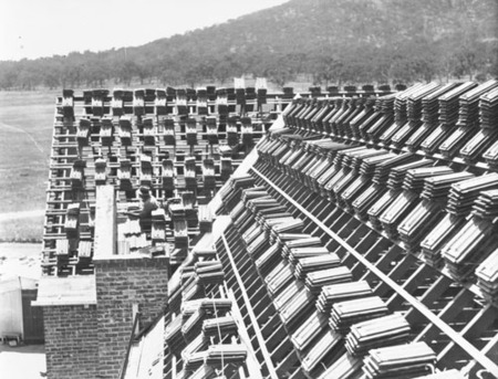 Tiles stacked on a roof - Ainslie Hotel, Limstone Avenue, Reid