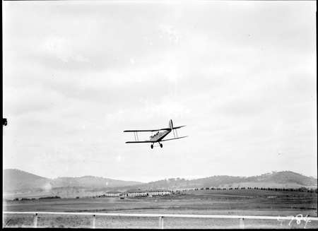 Aircraft landing on the review grounds in front of the Kurrajong Hotel.
