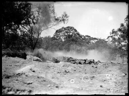 Explosion at a quarry face.