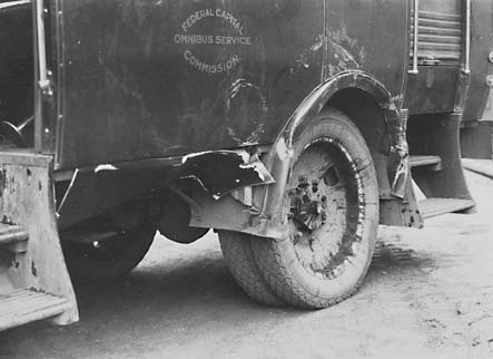 Damaged left hand side and wheel arch of  Bean bus after it had overturned