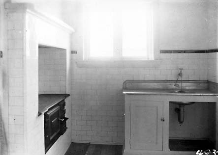 Cottage interiors,kitchen with wood stove and sink