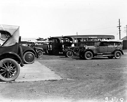 AEC Motor buses and Commonwealth motor cars with drivers at Kingston depot
