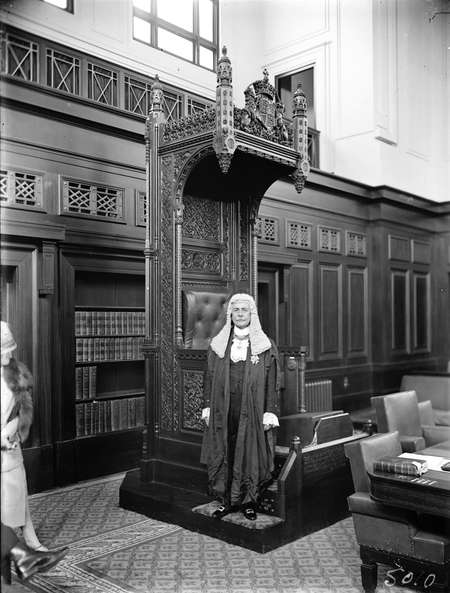 Opening of the 16th Parliament. Sir Littleton Groom at the Speakers Chair in the House of Representatives in his robes of office.