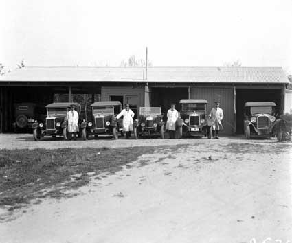 Six Federal Capital Commission motor cars with drivers at the Acton sub-garage - Drivers are (from left) Harold Strachan, George Edwards, Edward Tormey and Milton Purcell
